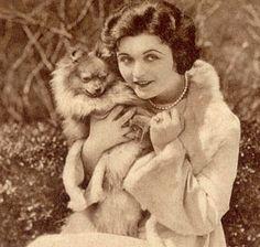 Actress Pola Negri with her glamorous little pomeranian!