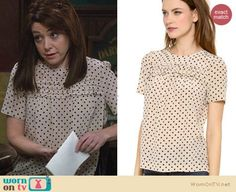 Lily's polka dot ruffled front top on How I Met Your Mother.  Outfit Details: https://wornontv.net/28819/ #HIMYM
