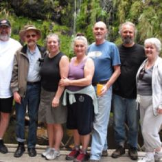 Trustees of Emissaries of Divine Light after swimming under the waterfall at High Noon in South Africa.