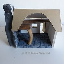 Interior of a simple stone cottage model in 1:48 scale. - Photo © 2013 Lesley Shepherd