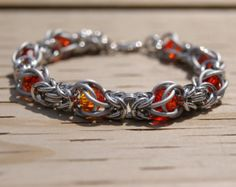 The Hunger Games Inspired Girl on Fire- Chainmaille Captive Byzantine Bracelet on Etsy -great use of fire Opal Swarovski beads Wire Jewelry, Beaded Jewelry, Jewelery, Handmade Jewelry, Diy Jewelry Projects, Jewelry Making Tutorials, Chainmaille Bracelet, Copper Bracelet, Chainmail Patterns