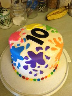 Pottery painting party rainbow cake.  Has 6 rainbow layers inside.