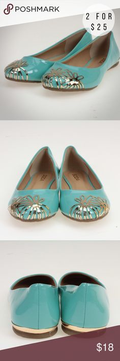 Turquoise & Gold Metal Flowers Flat These adorable flats will go with just about anything! They are made of all man made materials with a faux patent leather exterior and rubber sole. These cute spring and summer shoes have floral accents on the front and a bit of trim in a gold looking metal. Soda Shoes Flats & Loafers