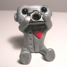 Sculpture $13 http://www.etsy.com/listing/58436435/camera-robot?ref=sr_gallery_40_includes%5B0%5D=tags_search_query=polymer+clay+robot_search_type=all_page=4_facet=polymer+clay+robot_view_type=gallery