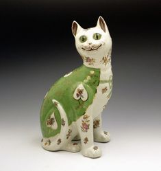 "A comical pottery figure of a seated cat with glass eyes in the style of Emille Galle Nancy (1890-1910). Largish (12"" tall).    Dimensions: 12.00 inch high"