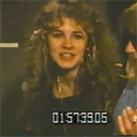 Stevie   ~ ☆♥❤♥☆ ~    fooling around and laughing with Christine McVie who's off to one side in this gif