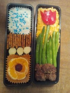 Fast and easy Bento... Right is rice pudding, crackers, string cheese, and a cutie.  The right is a bunch of green beans (under the rice), cheesy rice, some meatless meatballs from Trader Joe's (The best), and some green beans cooked with butter and salt.