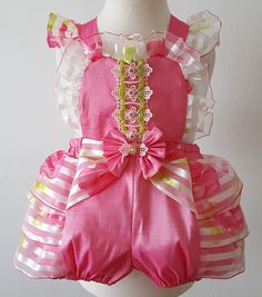 A personal favorite from my Etsy shop https://www.etsy.com/listing/464492373/girls-pink-romper-girls-ruffle-romper