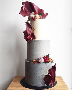I delivered this big guy to @showtime_events_centre, went home got my suitcase and straight to the airport   Sails inspired by @cakesbycliff  Flowers supplied by the bride #donttellcharles #wedding #weddingcake #concretecake #concrete #architecture #autum #showtimeevents #chocolatesails #ediblegoldleaf #sharpedges #cakedecorator #cakeinspo #weddinginspo #customcake #threetieredcake
