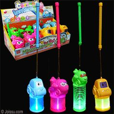 GOOFY VEHICLES FLASHING LANTERNS. Just slide the switch to see the lights flash and change colors through the expandable magic coil. Batteries included. Assorted colors and styles. Size 4 Inch lantern