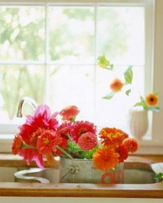 antique flower bucket holds assortment of 'Emory Paul' and 'Andries' Orange' dahlias and Giant zinnias.