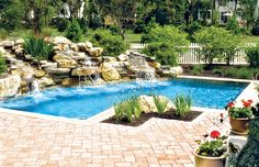 Geometric swimming pool with large rock waterfall