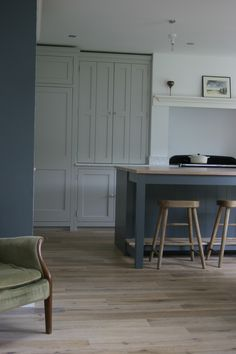Painted in Farrow & Ball Pavilion Grey with the island in Down Pipe.