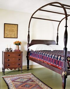 incredible bed. ♥ the rug and blanket, dresser