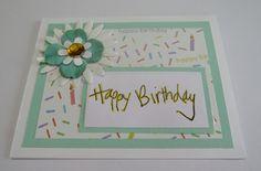 Handmade birthday card.  Aqua flower and candles.