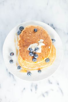 brown rice flour pancakes with coconut butter + blueberries