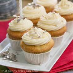 Vanilla cupcakes topped with cream cheese frosting.