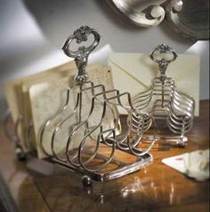 A traditional silver toast holder is a great tool to organize your desk