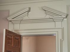 Ante room with ionic pilasters on doorcase broken for Garderobe odessa