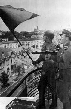 Lviv, Ukraine, Soviet soldiers waving a flag above the city, 27/07/1944.