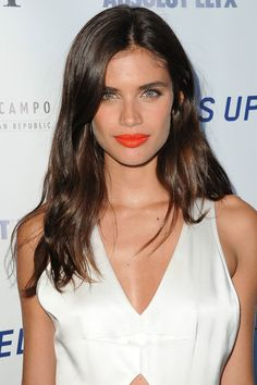 Who: Sara Sampaio What: Tangerine Hit How-To: The model epitomized laidback summer cool in an easy jumpsuit and air-dried hair, but her punchy orange lipstick is what took the look up a notch and made it perfect for a late-night pool party. To keep electric color from shocking, stick to mattes and creamy formulas over high-shine glosses. Editor's Pick: NARS Audacious Lipstick in Geraldine, $32, sephora.com. - HarpersBAZAAR.com