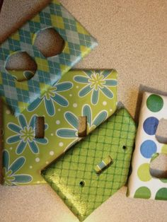 "Scrapbook paper remnants, ugly old switch plates, and Mod Podge = great new room detail! I can't wait to do these in other rooms too. We wanted to coordinate but didn't want ""Matchy Matchy"" for the kids' computer room. Love the result! Got the idea here: http://housewivesofriverton.blogspot.com/2011/10/covered-light-switch-outlet-plates.html We cut the openings out differently because I didn't want to paint them. We cut X's for the square openings and wedge-shaped cuts for the hexagonal…"