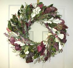 Tranquility Lane Eucalyptus Blended Wreath (24 inch) by In the Garden and More. $62.99. Romantic and beautiful. Handcrafted by skilled artisans. Full and fabulous colors and textures. Beautiful blend of burgundy, green and white eucalyptus. Size is 24 inches in diameter x 6 inches deep. This beautiful 24 inch wreath will add lots of color with its shades burgundy, green and highlights of white and it is sure to please just about every taste in decor. The green & burgu...