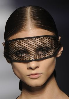 creative use of fabric for a mask… you could do something like this using fishnets