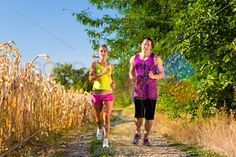stock photo of rural sports couple jogging for fitness on a beautiful summer day