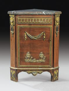A GILT-BRONZE MOUNTED TULIPWOOD ENCOIGNURE, LOUIS XVI, ATTRIBUTED TO NICOLAS PETIT, CIRCA 1770-1775
