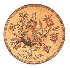 "Pook & Pook. Nov. 11th & 12th 2011. Lot 1.  Estimated: $15000 - $20000. Realized Price: $18960. Montgomery County, Pennsylvania sgraffito redware charger, attributed to Henry Roudebush, ca. 1810, decorated with a central bird perched on a tulip vine, 13 3/4"" dia."