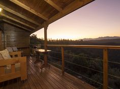 The spacious deck at CliffEdge Cottage with the Outeniqua Mountains in the background.