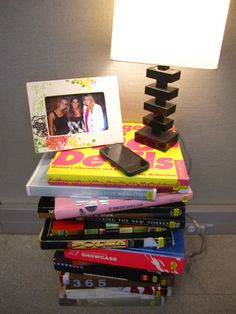 Stackable Literature   A textbook solution: Stack old books next to your bed to create a funky, cool nightstand. Who knew required reading could look so chic?!