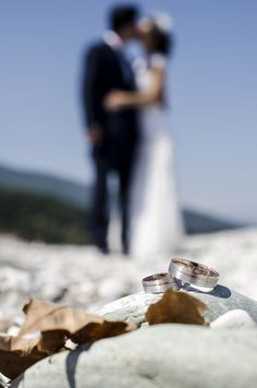 Beautiful couple kissing in the background and their wedding rings!