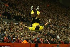 The Gabon international Pierre-Emerick Aubameyang celebrates with a somersault as the German side  caused havoc in the opening moments of Borussia Dortmund's game at Liverpool, when they looked far superior to the Reds