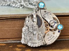 steampunk necklace - ONCE UPON a TIME - antique year 1916 Elgin watch movement necklace with castle and Swarovski aqua color rhinestones on Etsy, 20921,05Ft