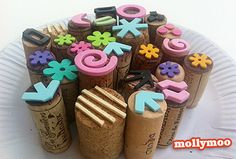 Glue foam stamps (or anything else) to wine corks to make a handle for it.