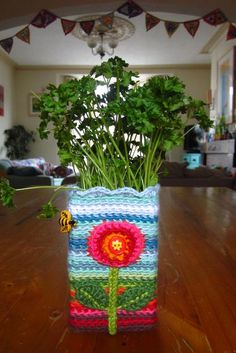Herb pot cover.  Never thought of such a thing.  Too cute.