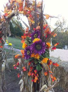 Autumn Wedding Arch... I'm a fan of the pheasant feathers :)