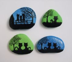 Hand painted stone magnets with Cats: Original art painting on pebbles The pebbles are painted with watercolour (background) and black ink and sprayed with varnish. Approximate size: One cat: 1.3x1.3 (3.3cmx3.3cm) Two cats: 1.8x1.4 (4.5cmx3.5cm) Three cats: 2x1.5 (5cmx3.8cm)  I custom paint on stones and shells and can paint something special for you in silhouette style: a special picture, word, name, initials, date, phrase....  More painted stones…