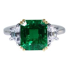 Platinum, yellow gold, emerald and diamond ring, set in the center with an emerald-cut emerald weighing carats, flanked by 2 trapezoid diamonds weighing ct. Emerald Jewelry, Diamond Jewelry, Gold Jewelry, Jewelry Rings, Fine Jewelry, Emerald Rings, Peridot Jewelry, Ruby Rings, Gold Bracelets