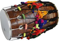 MAHARAJA Dhol Sheesham Wood Natural Color (PDI-HF) by buyRaagini.com. $359.00. The Dhol, or Punjabi bhangra dhol as it is popularly come to have known as, is a common Percussion Instrument used in Punjabi Folk Music. Dhol makes an extremely loud sound and is played with two sticks made from cane and bamboo respectively. The dhol is slung over the neck of the player with a strap made of ropes or woven cloth and played.  While we ship the dhols to our clients worldwide, we tune ...