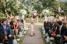 Metallic bridesmaid dress Aisle decor Wedding lanterns Ceremony floral design