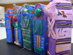 Recycled Milk Carton Sarcophagus  Photos and step-by-step instructions at www.onceuponanartroom.com