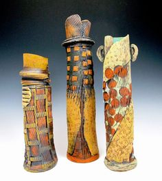 Tall vessels, earthenware with oxides, underglazes and interior glaze. METaylor