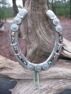 """Hot off the hoofs!  Hand beaded luck catcher is sure to get a second look.  Legend has it that horseshoes hung upside down will """"catch the luck"""" coming in and out of your house.  Holds the luck till you need it!  Taken off a World Champion barrel racing horse."""