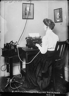 """Blind stenographer using Dictaphone on April 27, 1911. This could have taken place at the New York Association for the Blind. On the day before this photo was taken, April 26, 1911, President Taft was at the Metropolitan Opera House where he opened the Blind Workers' Exhibition. The New York Times wrote, """"While he [Taft] spoke, a blind stenographer 'took notes' on a specially prepared machine…."""" The exhibition was arranged by Miss Winifred Holt, Secretary of the New York Association for the Blind."""