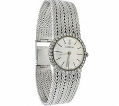 """Corum White Gold Lady's Watch.  Corum 1960's 18K White Gold Lady's Wrist Watch with 36 round brilliant diamonds +/- .80ct. G-H/VS quality, set in bezel. Swiss mechanical movement, silver hash mark dial.  6 1/4"""" - 6 1/2"""", slightly tapered bracelet, width 1/2"""" - 3/4"""". One year guarantee on the movement only! Item Number: WOO633"""