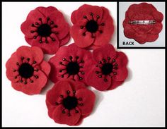 Red Poppy Brooch/Pin - Hand Made from Felt with Black seed Beads. Was thinking that for the wedding, in lieu of getting flowers, to donate to the disabled veterans fund and just have the family wear the poppy pins. Since they don't sell the poppies made during veterans day...only donation in exchange of one...