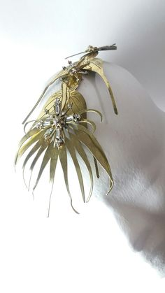 A scultured golden bride wedding party spray headpiece by Marco Apollonio